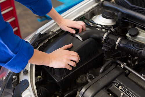 Mechanic hands under hood